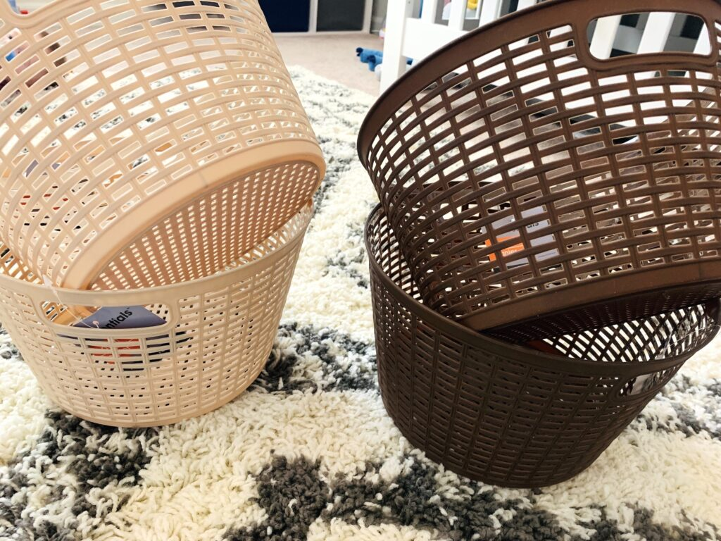 Four smaller plastic (laundry) baskets in cream and brown